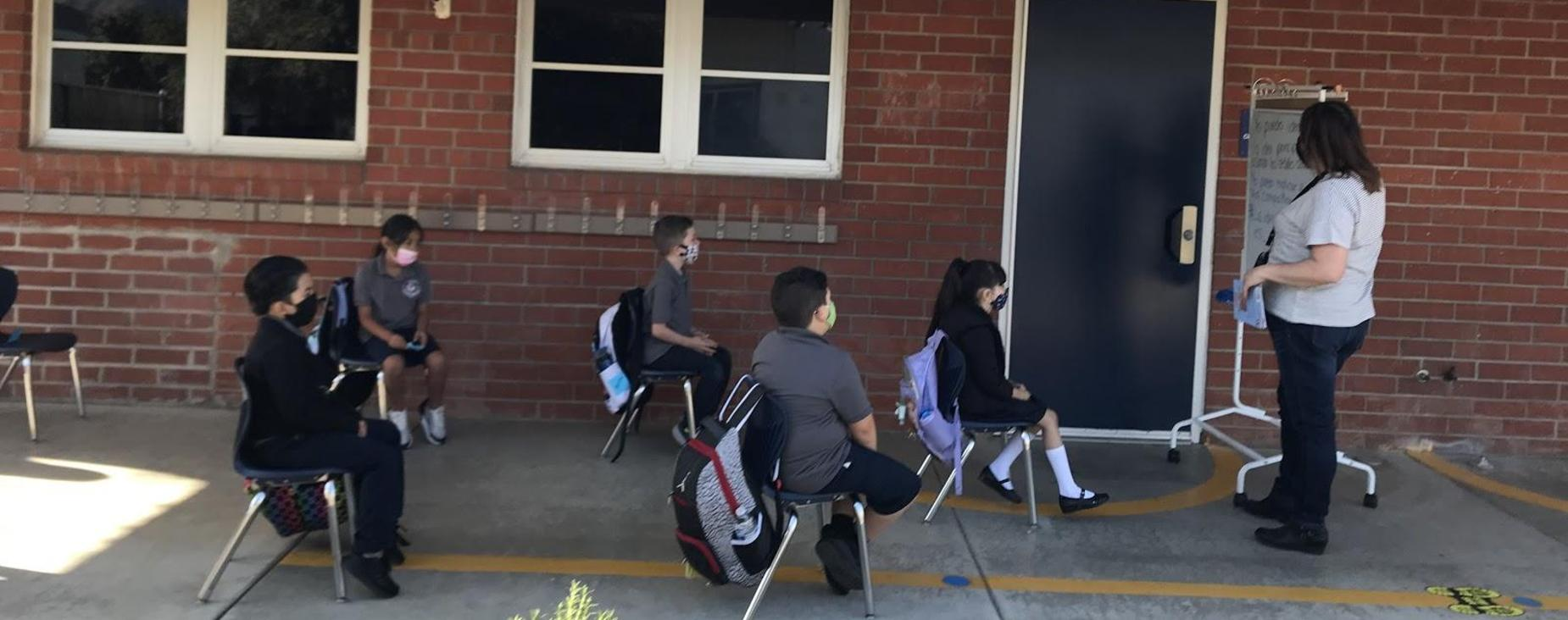 Teacher outside with students