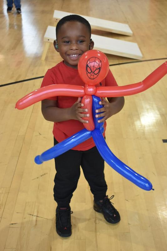 WTSD Fall Festival - Student of Color with balloon