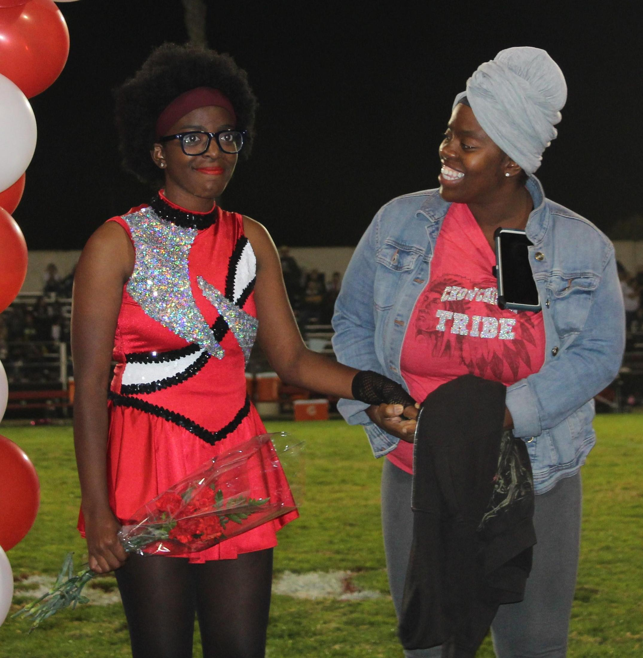Aoleon Johnson Charles and her supporters at Senior Night.