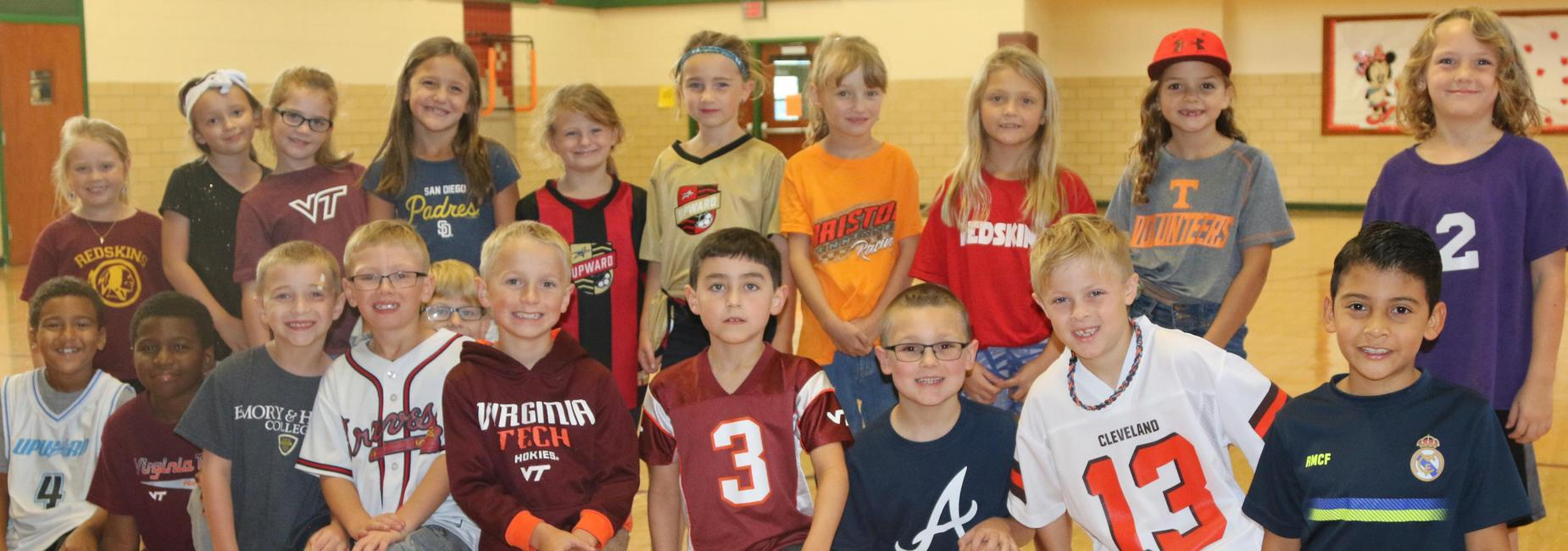 Students shown wearing their Favorite Sports Team attire