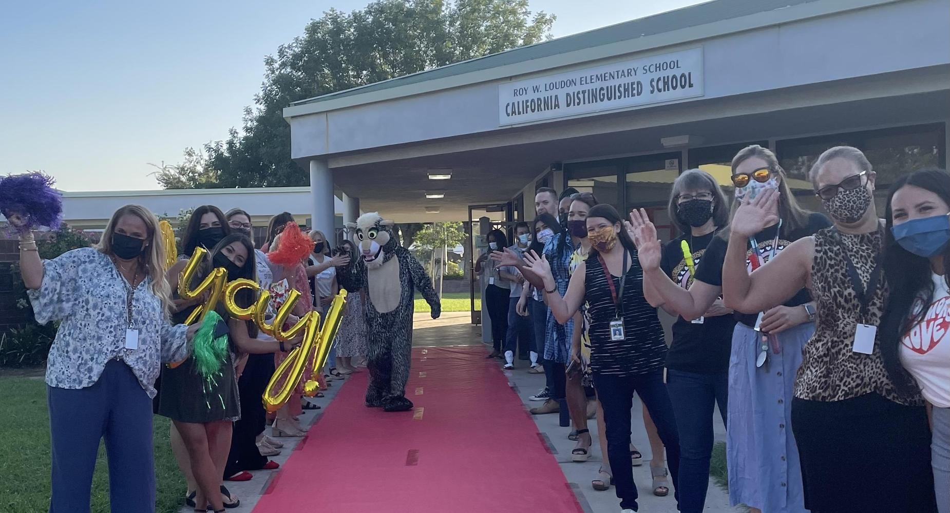 Teachers welcoming back students