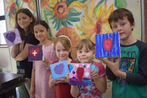 kids holding artwork