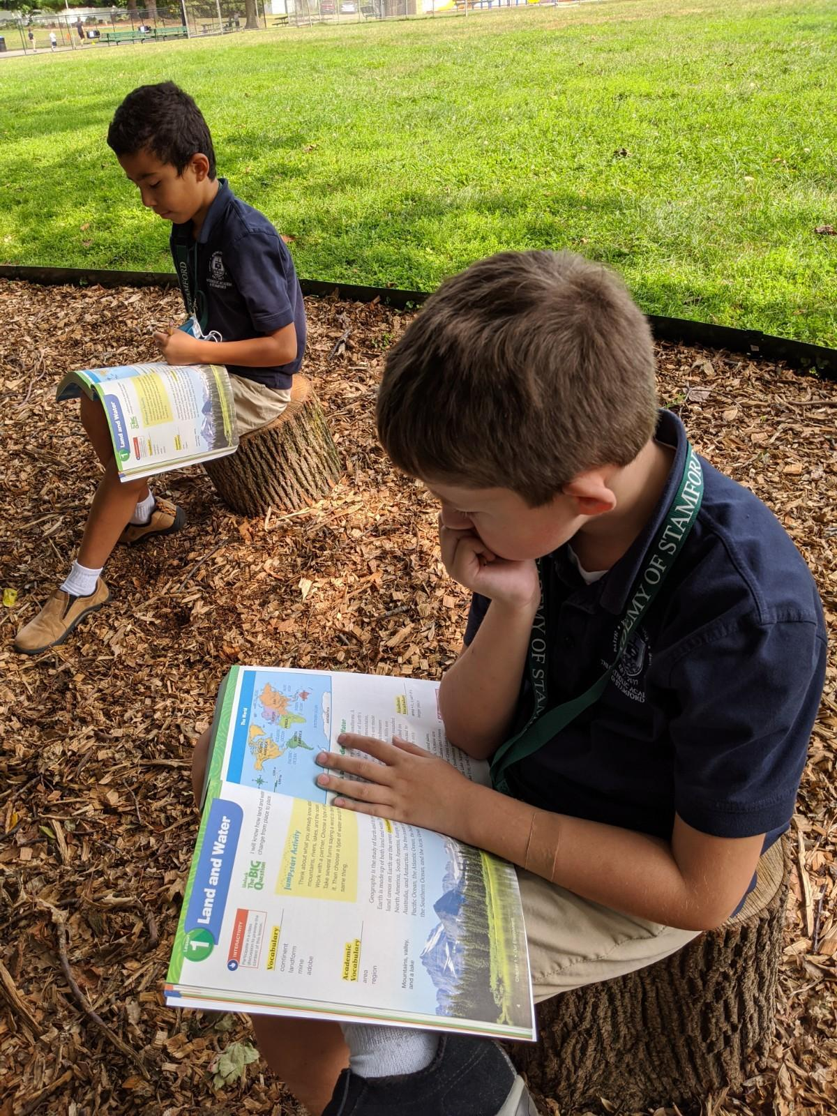 CAS student studying in outdoor class space