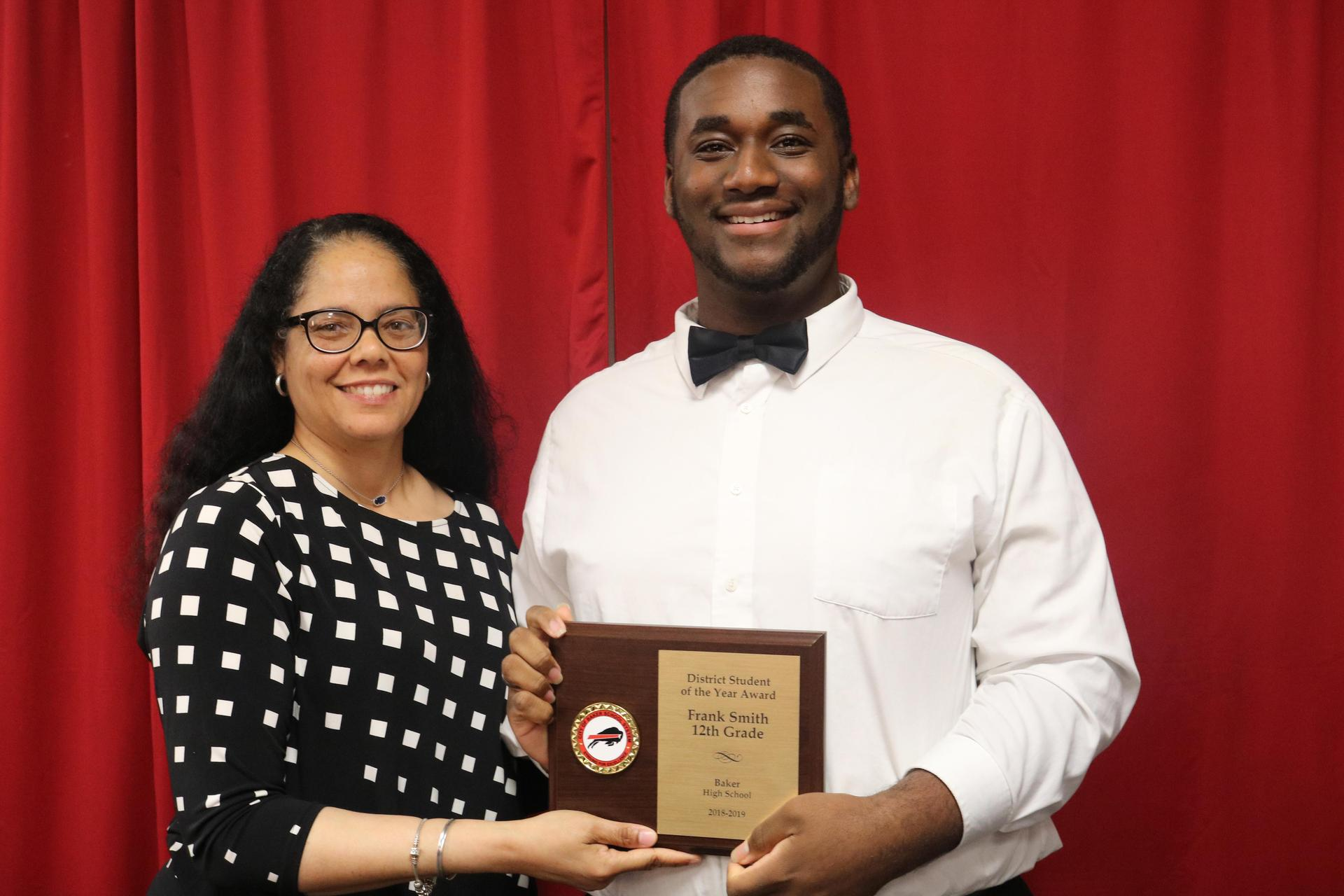 a photo of CBSS 2018-19 student of the year with board president Boxie