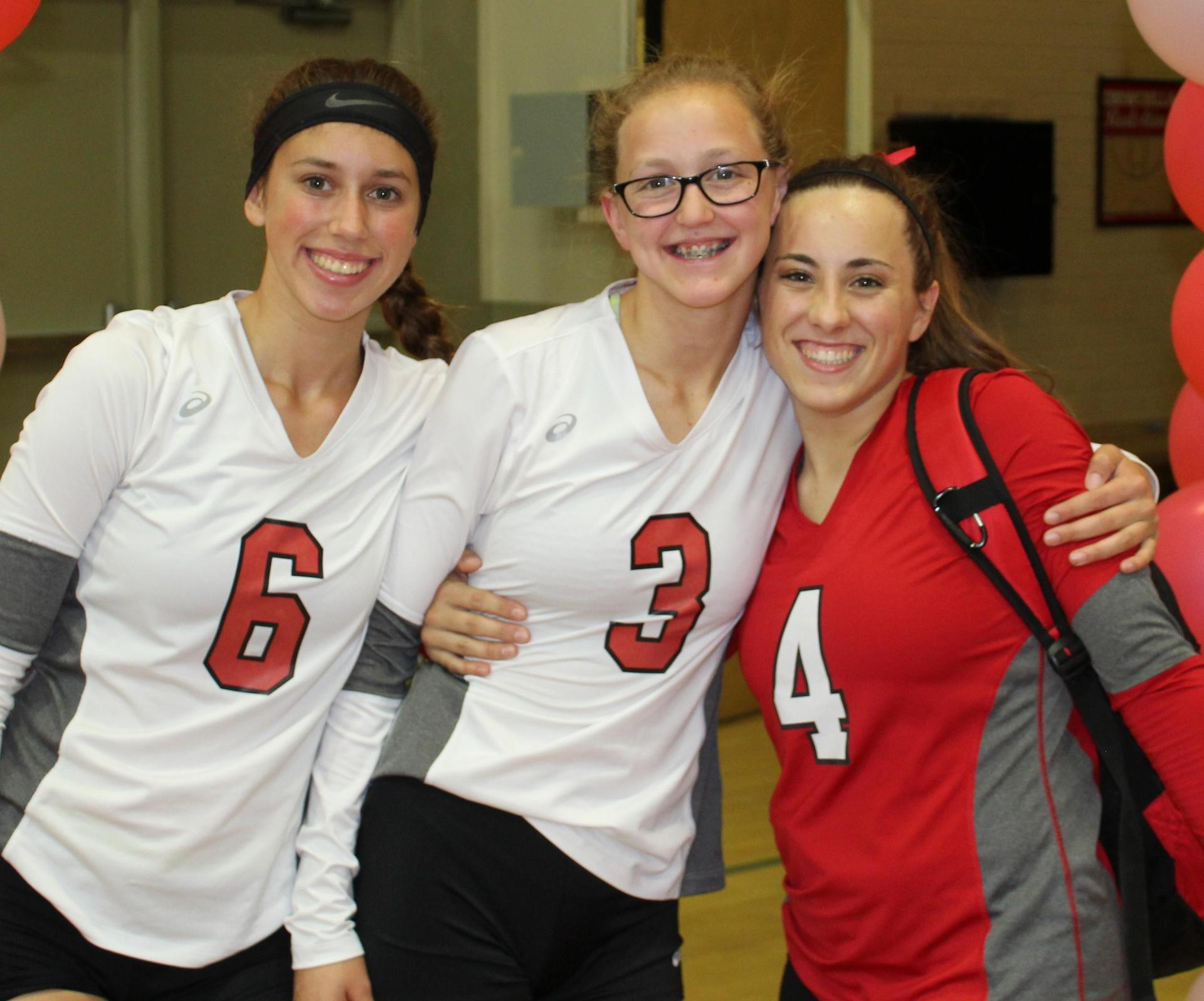 Savannah Bass, Lauren Bass, and Hannah Mancebo pose on Volleyball Senior Night.