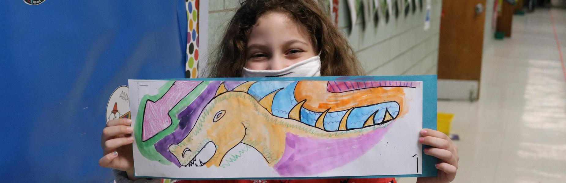 Photo of Franklin 2nd grader showing watercolor painting of Chinese dragon.