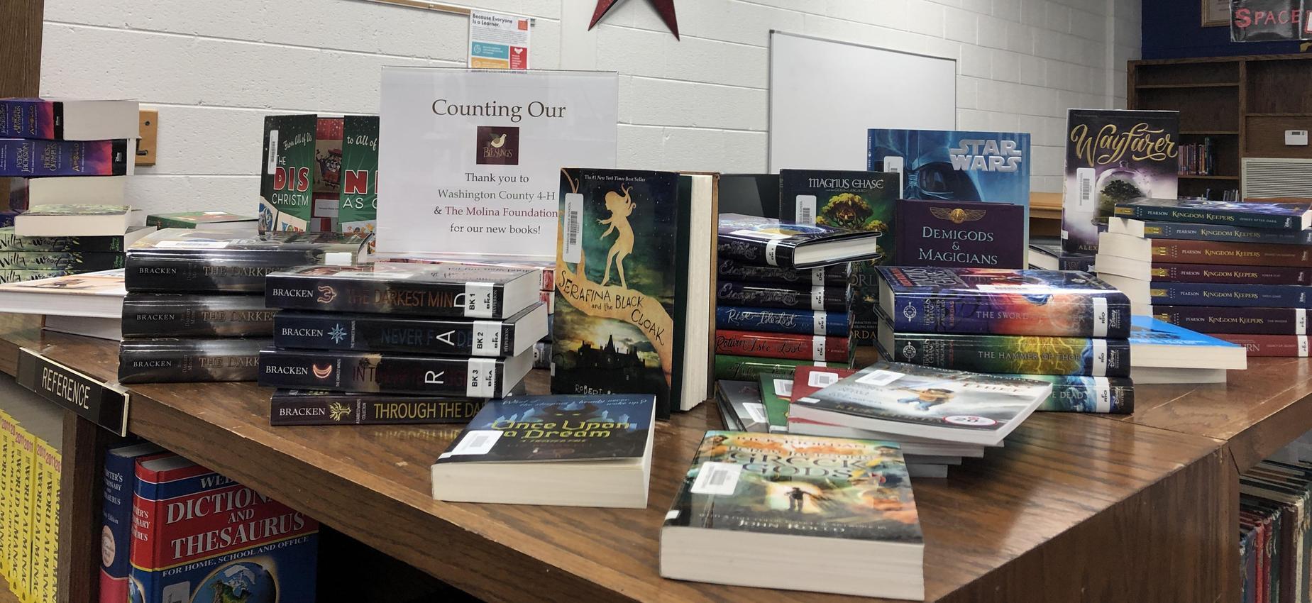 Books on top of a book shelf.