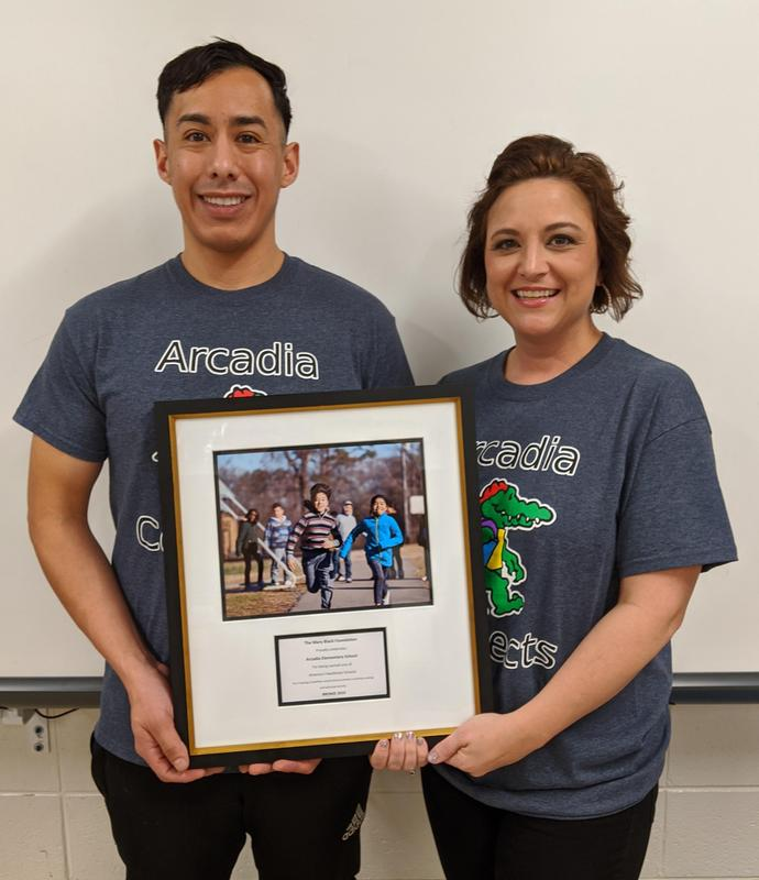 Coach  Guerrero  and Mrs. Perry with recognition plaque
