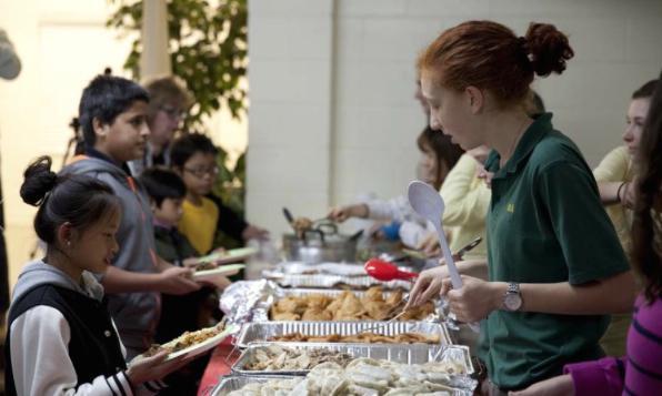 Students serving food