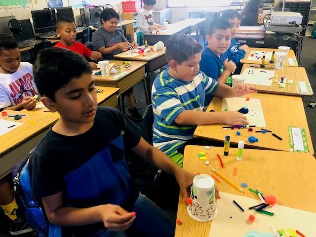 Boys making Art Cups