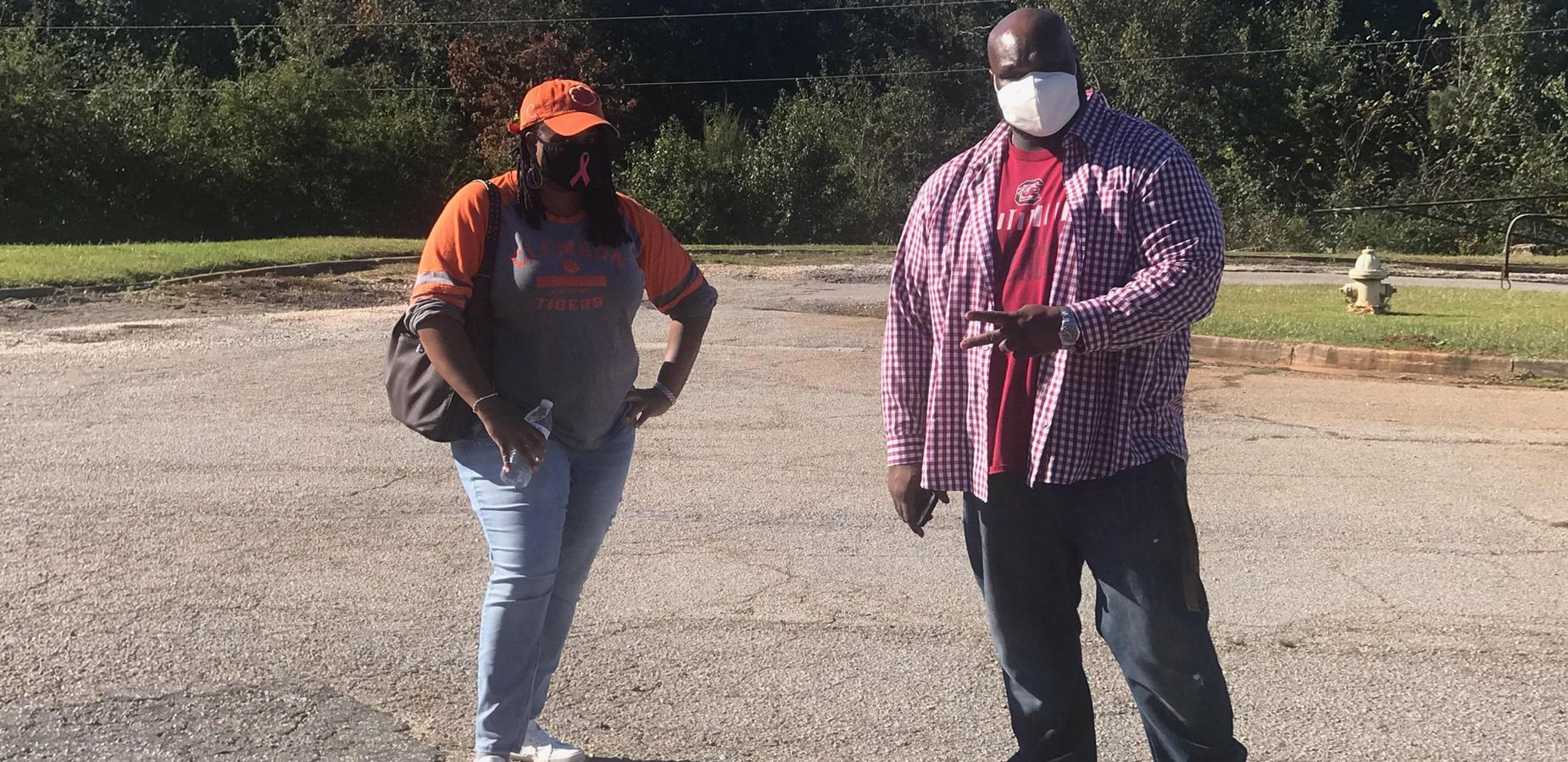 Ms. Gratic and Mr. Bobian in Clemson and USC gear