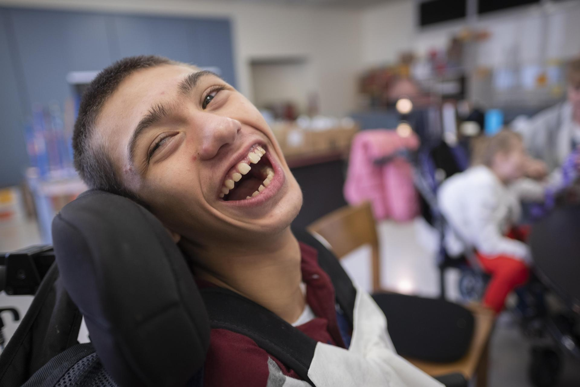 student smiling in class