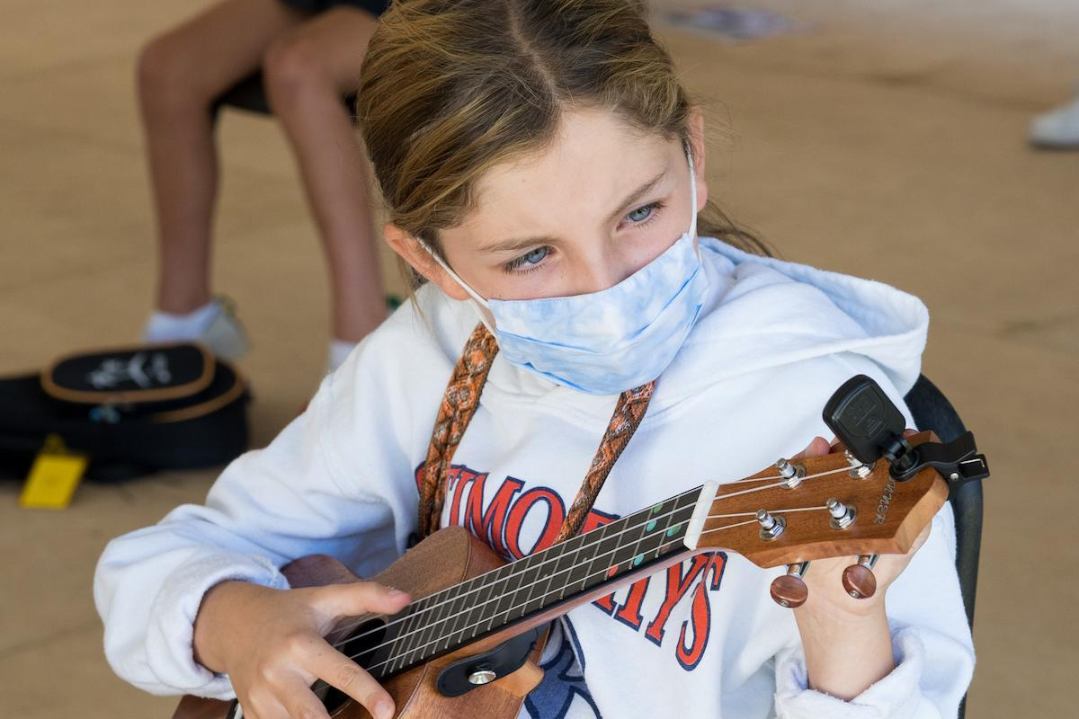 St. Timothy's School fourth grader playing the ukulele in music class