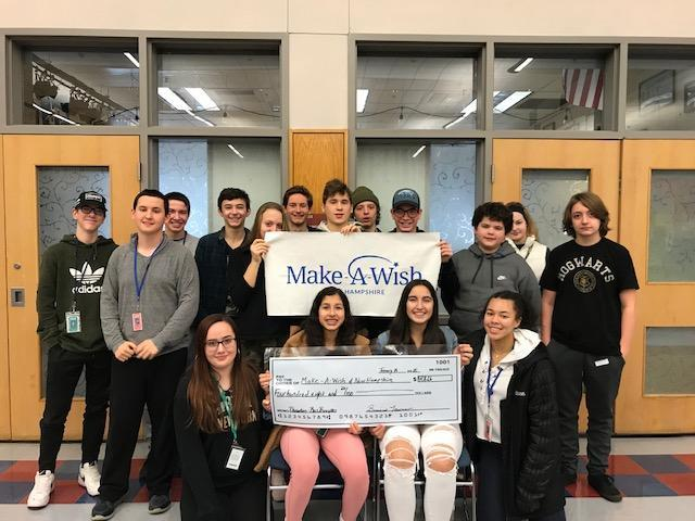 Students with oversize Make A Wish donation check