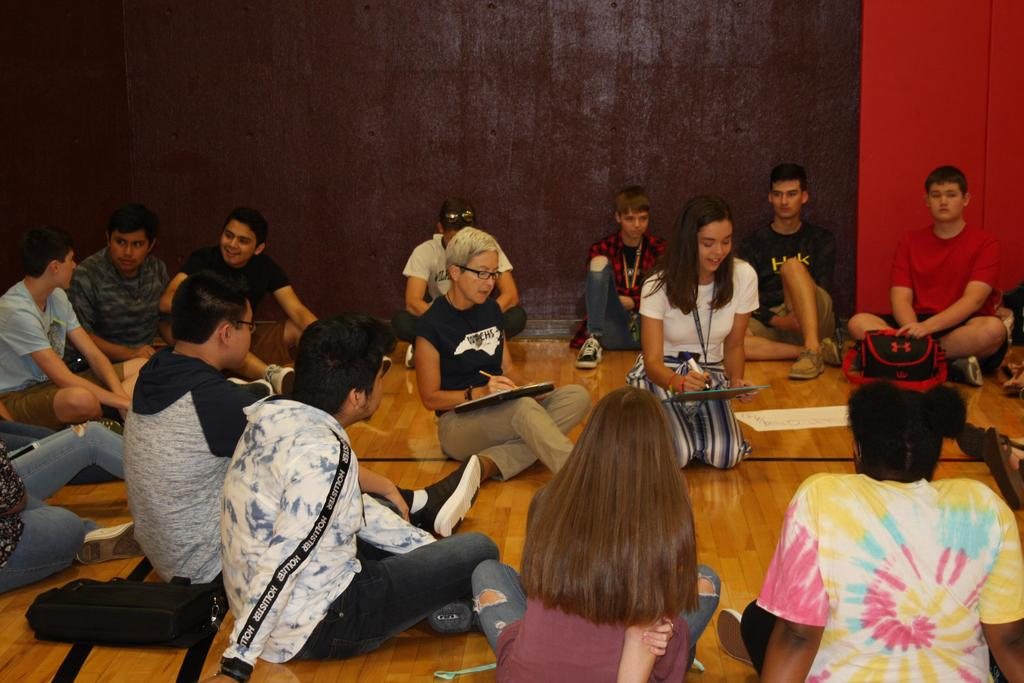 Teachers and students engage in team building activities on the first day of school at WECHS