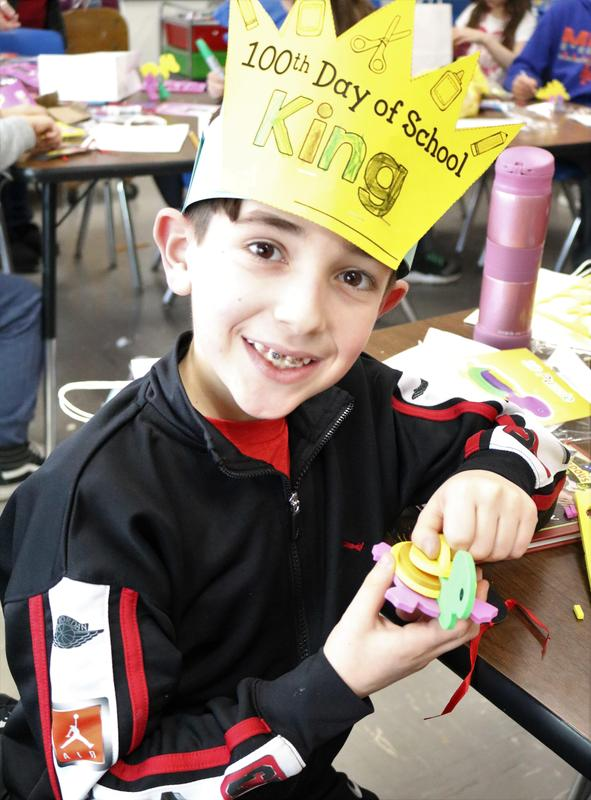 Photo of a Jefferson School student wearing a 100th Day of School hat and enjoying Valentine's Day activities.