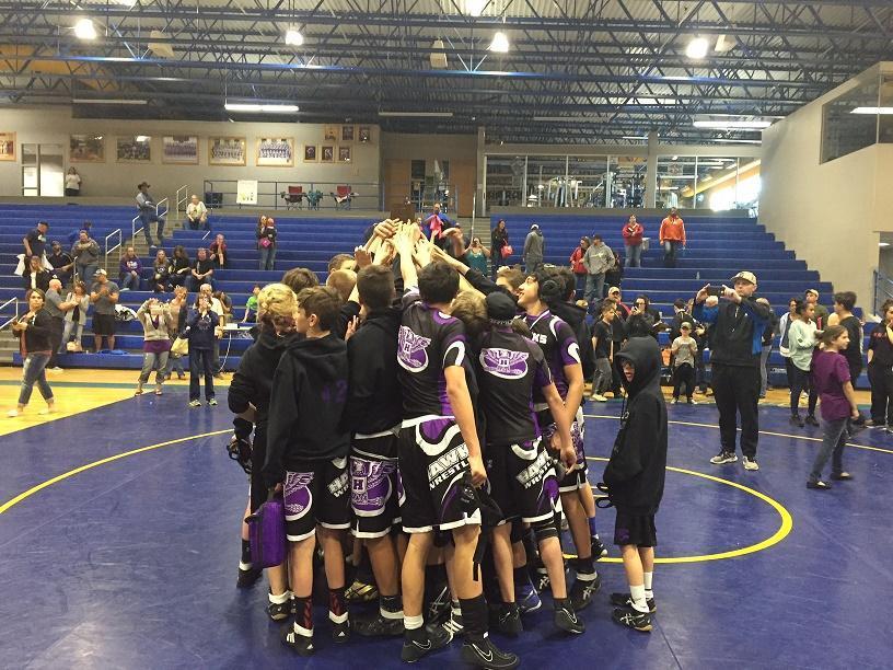 Wrestlers huddle