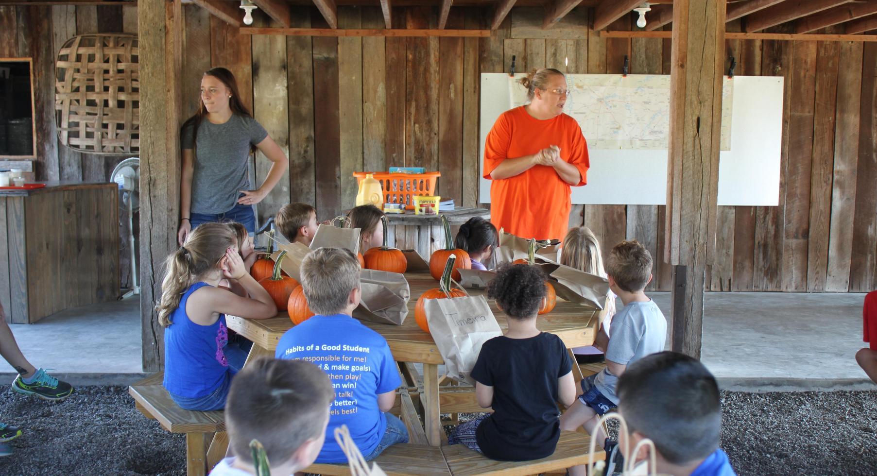 Kindergarten learns about pumpkins at Myer's Pumpkin Patch.