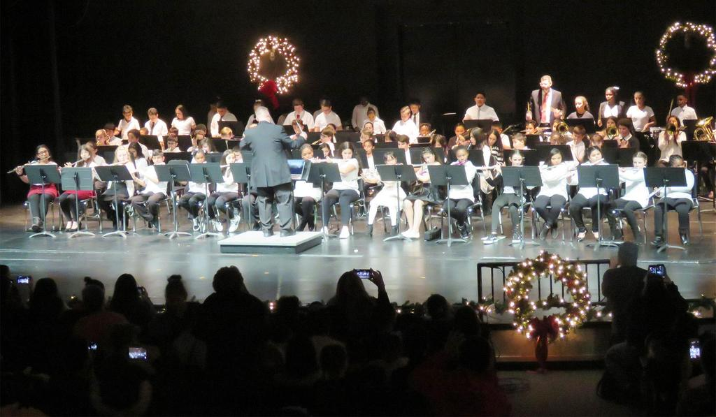 A wide-angle view of the entire fifth grade band and the back of the conductor