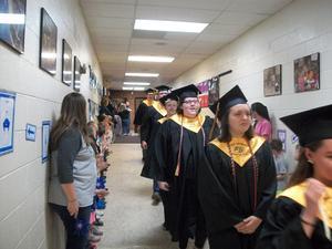 East Davidson Graduates parade through Pilot's halls.