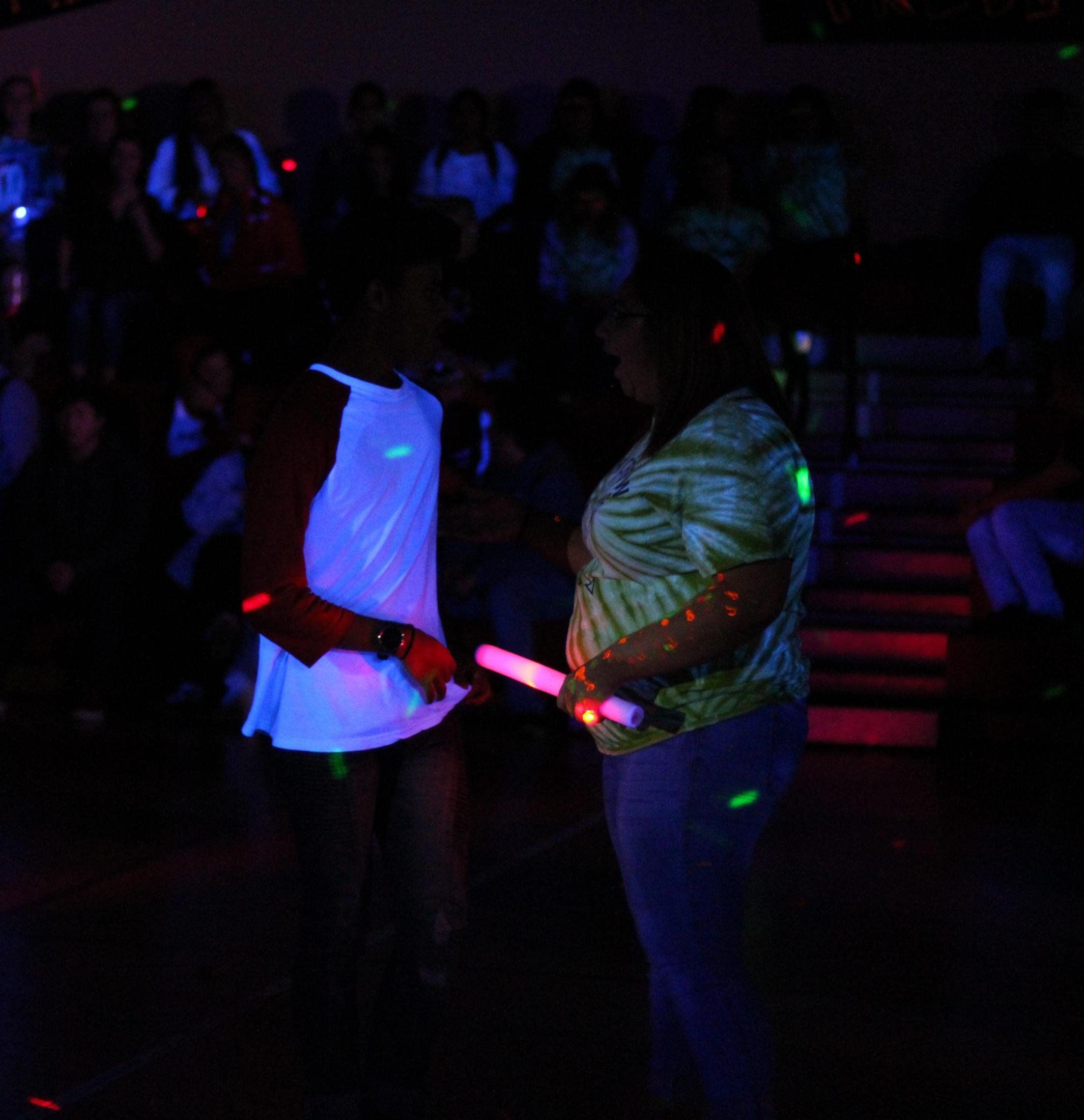 Students having fun at the Blacklight Rally