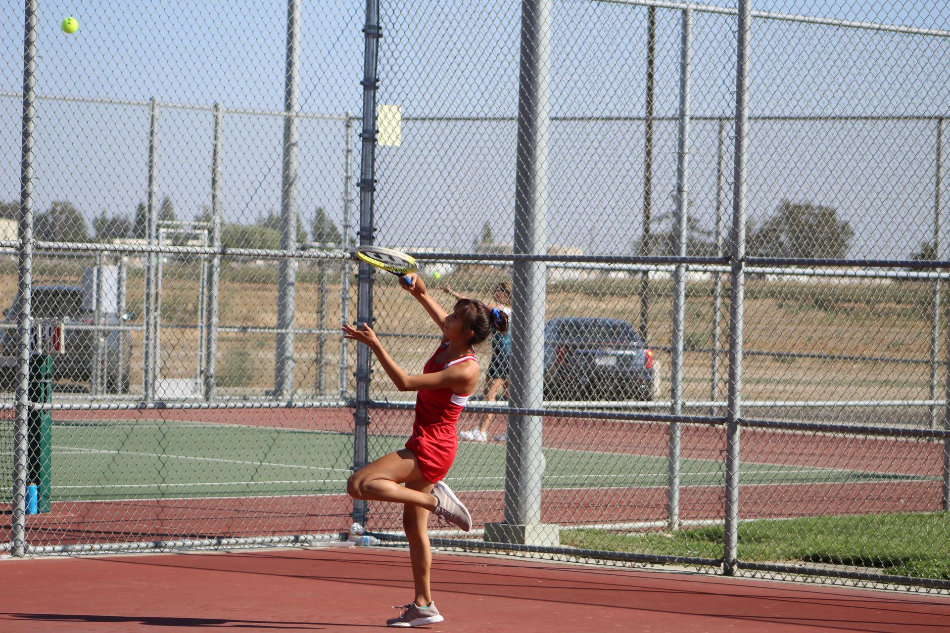 girls playing tennis against Yosemite