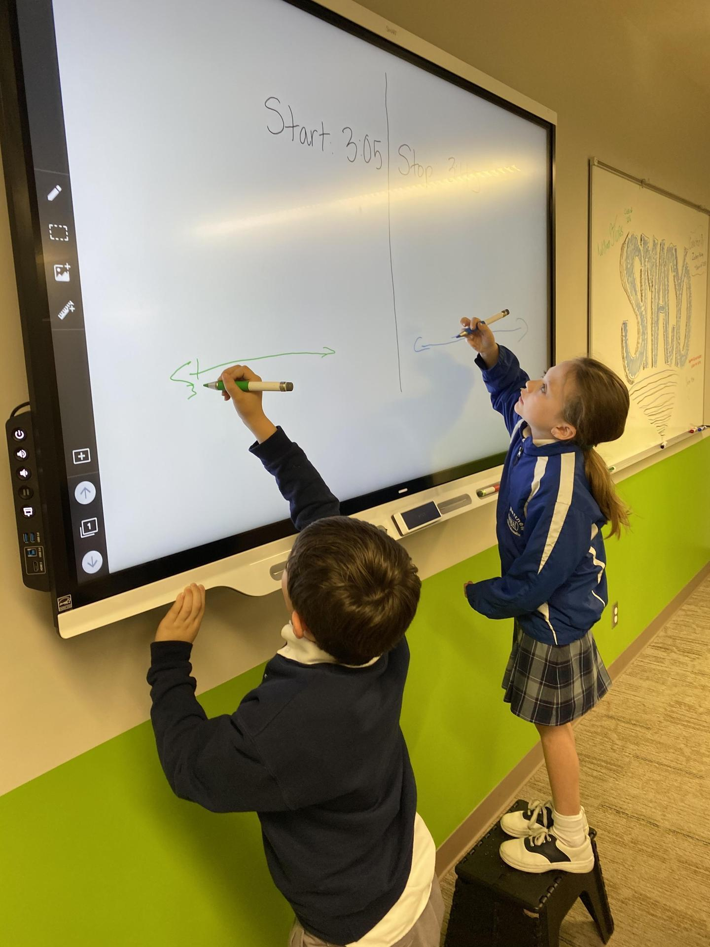 Students using SmartBoard