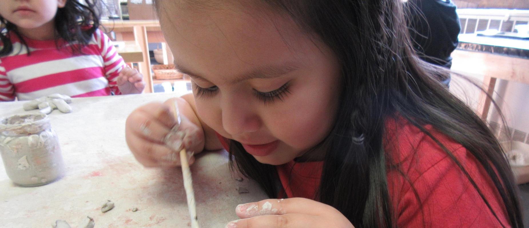 girl creating with clay