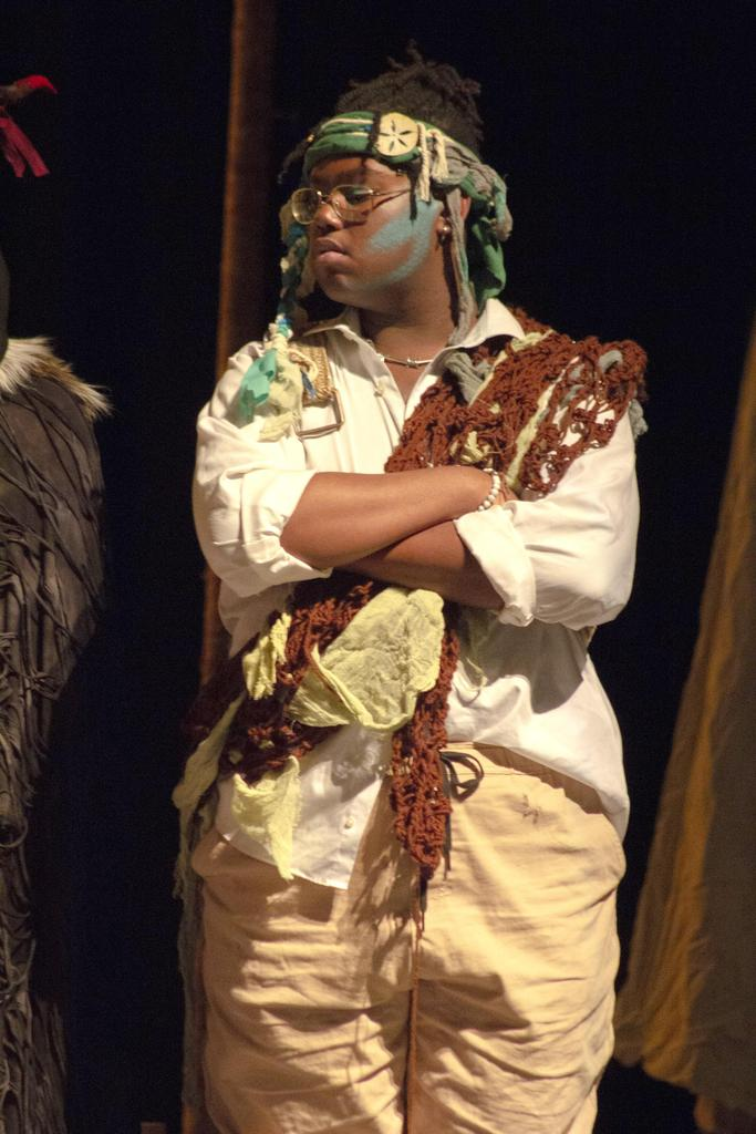 A single cast member, arms crossed, during the EHS Theatre Company production of Once On This Island