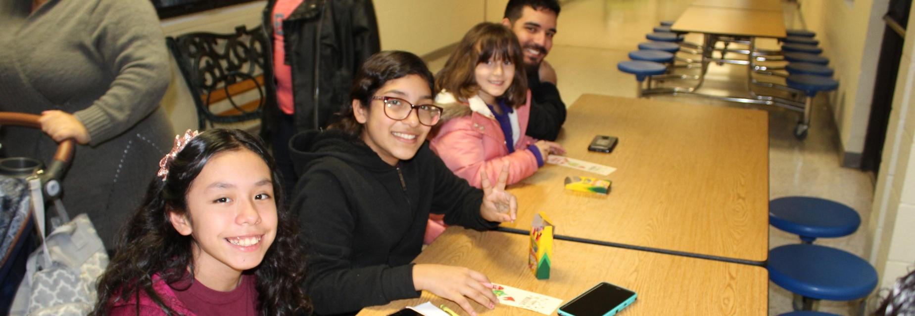 Students and parent making bookmarks