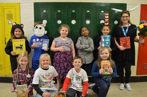 Students and their teacher dresses as book characters.