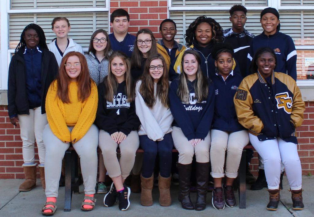 group photograph of educators rising students