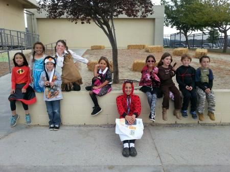 Mrs. Sallons and children in costume