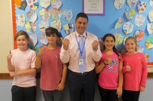Photo of students and principal Brian Gechtman wearing pink for RIS annual Pink Out in recognition of Breast Cancer Awareness Month.