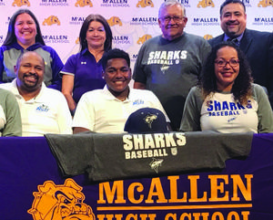 McHi baseball player signs with college