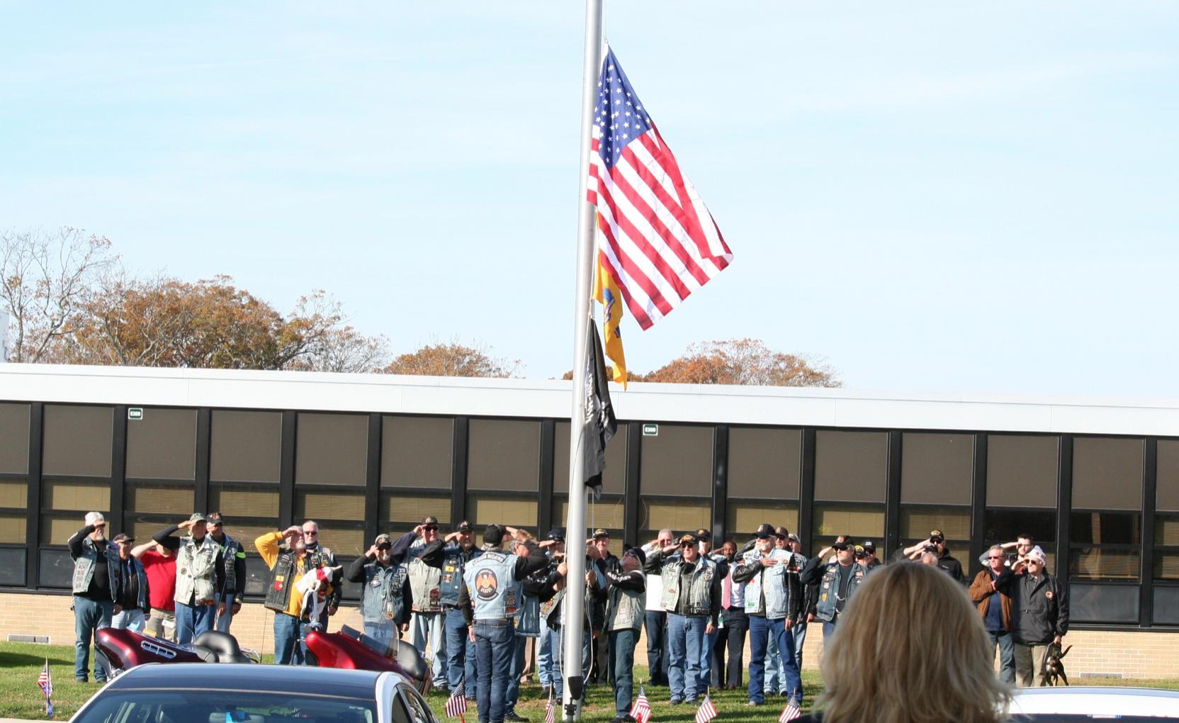 Veterans raise the flag outside of MRHS