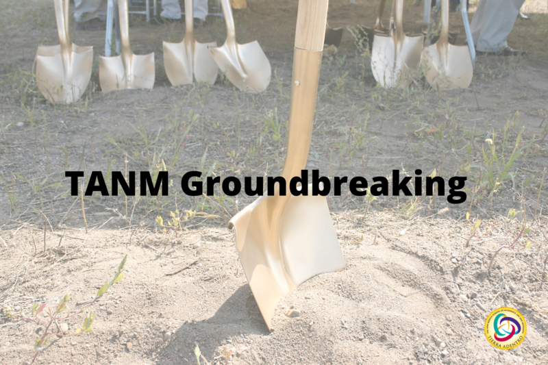 A picture of a shovel digging into dirt with a line of shovels in the background. The text reads