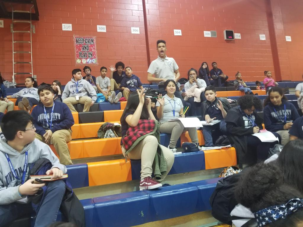 uhms students cheering in the bleachers