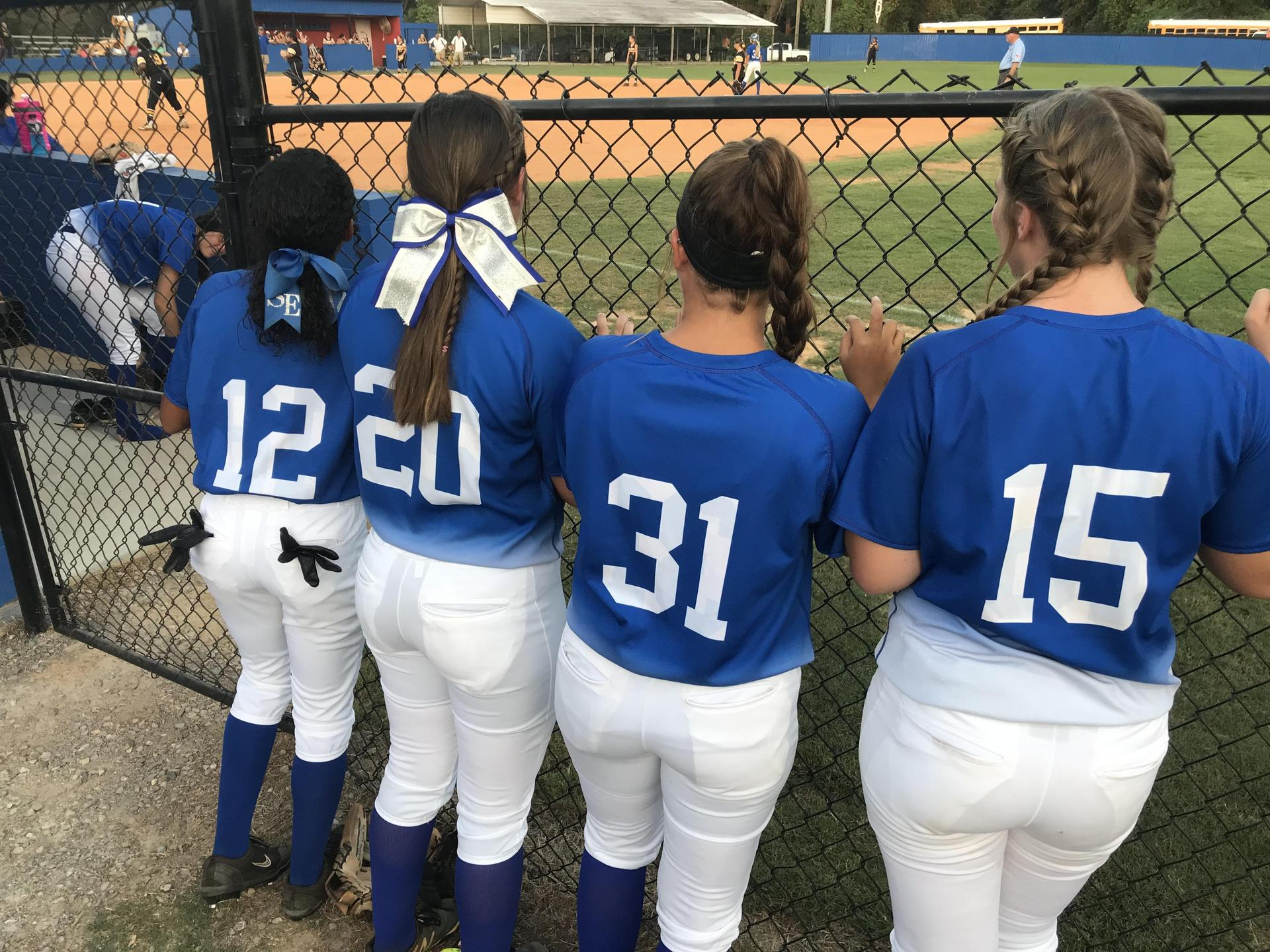 SEHS softball players gazing at a game.