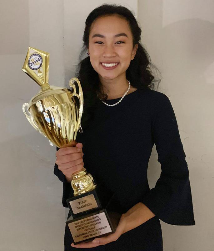 Gabrielino student poses for a photo with her state champion trophy.