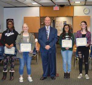4 student B3T essay winners with District Superintendent, Dr. Lee posing with their certificates