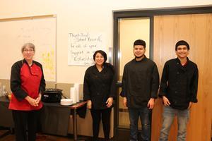 Culinary students serve board members