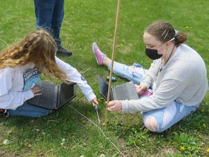Students work together to collect temperature and light data.