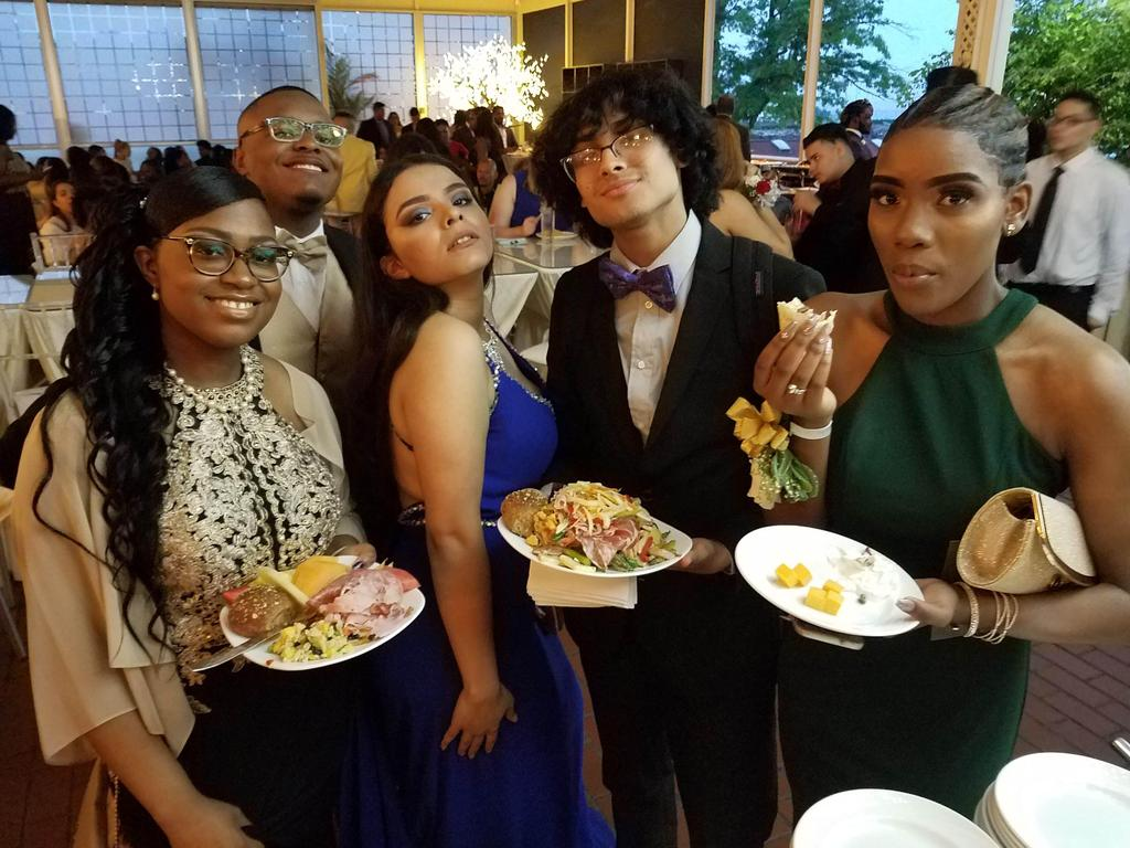 four students with plates of food