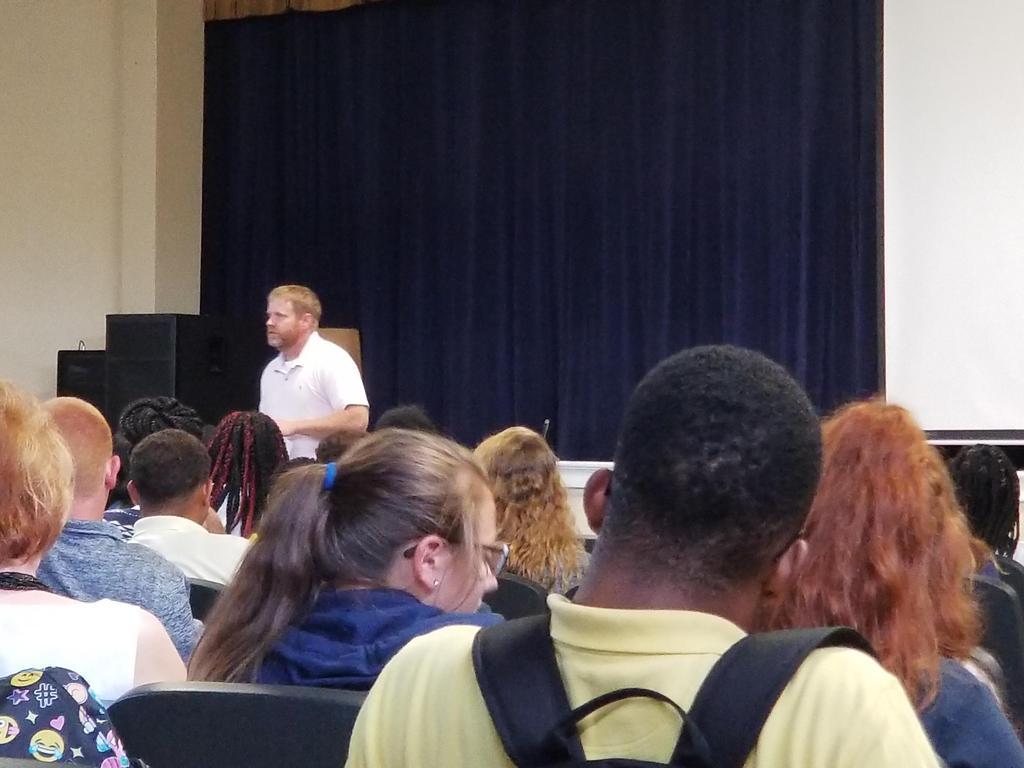 mr calcote addressing students in auditorium