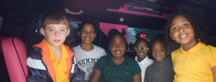 Summit Elementary Scholars rewarded with Hummer Limo ride and pizza party for being top sellers in school fundraiser