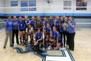 lois with 2018 volleyball team, sectional champions.JPG