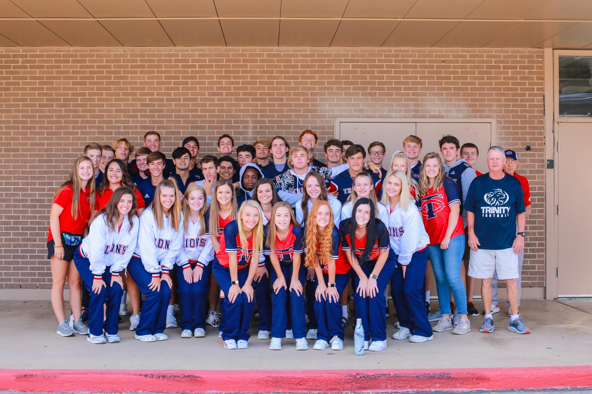 high school football team and cheerleaders