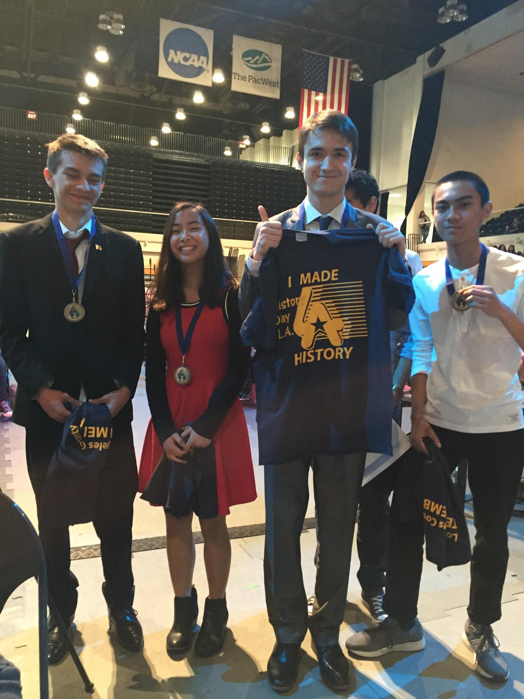 Group of students with shirts and medals