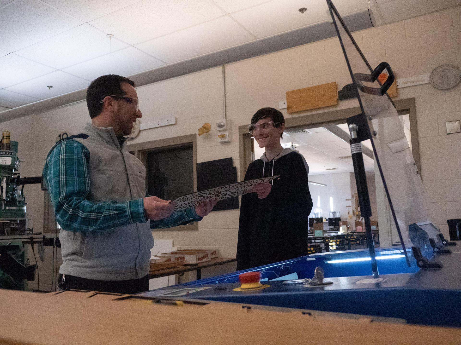 Mr. Xydias and student with laser cutter